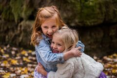 2 Girls Hugging Each Other Outdoor during Daytime Stock Image