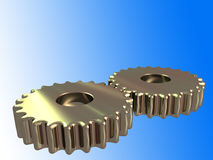 2 golden cogs with clipping path. Close-up of 2 red-golden metal cogs on a blue gradient isolated with clipping path Stock Image