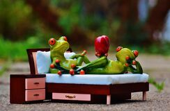 2 Green Frog on Bed Figurine Royalty Free Stock Photography