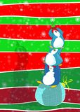 2 greenies. 3 penguins on a cyan decorative ball are on equilibrium to get high and higher a little green three royalty free illustration
