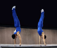 2 gymnasts on parallel bars Stock Image