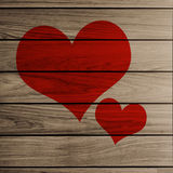2 heart on Wooden plank brown. Texture background Stock Images