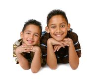 2 Hispanic Young Brothers Smiling. Hispanic Young Brothers Smiling on White Background Royalty Free Stock Photography
