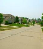 2 hogares suburbanos del ladrillo de la historia Fotos de archivo libres de regalías