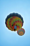 2 hot air balloons. Two hot air balloons floating and flying up high Royalty Free Stock Photography