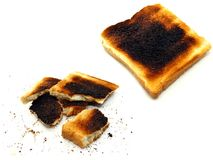 2 images of burnt toast. On a white background stock photos