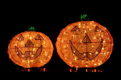 2 Jack-O-Lanterns Lit Up on Black Background Stock Photos