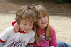 2 kids in the sandbox. 2 siblings in the sandbox Stock Photos