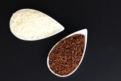 2 Kind Of Raw Thai Rice Thai Jasmine Rice And Brown Rice In White Cups On Black Background Stock Photography