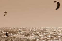 2 Kite Surfers in sepia Stock Image