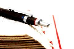 2 krawędzi książka długopis Fotografia Stock