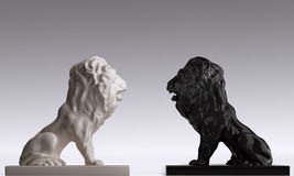 2 lions. Two statues of lions of resisting to each other Stock Image