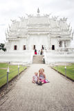 2 little girls (tourist) by Wat Rong Khun Royalty Free Stock Photography