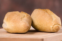 2 loaves of bread. A closeup of 2 mini baguettes, placed on a cutting board royalty free stock images