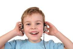 2 lyckliga hörlurar för pojke Fotografering för Bildbyråer