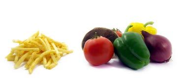 2 malsains sains de nourriture Image stock