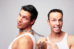 2 man chain. Friendship steel chain men in underwear Stock Photos