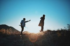 2 Man Standing on Mountain during Day Time Royalty Free Stock Photo