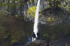 2 Men's Watching Water Falls during Daytime Stock Images