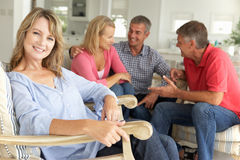 2 Mid age couples socialising at home royalty free stock image