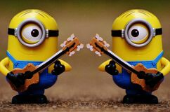 2 Minion Holding Guitar Toy Royalty Free Stock Images