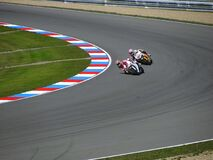 2 Motorcycle Racing on Asphalt Road during Daytime Stock Photo