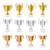 2 nagrody brązowieją złocistych setu srebra trofea Fotografia Stock