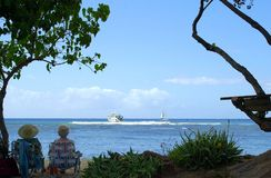 2 old ladies on vacation. Relaxing in Waikiki, Hawaii royalty free stock images