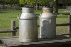 2 old milk cans Stock Photos