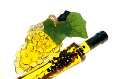 2 Olive Oil Bottles. Grape bunch shaped bottle & bottle with herbs & spices added stock image
