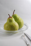 2 pear. 2 green pears on plate Stock Photography