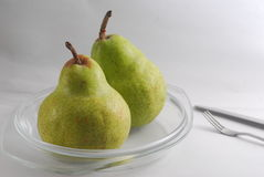 2 pears. 2 green pears on a plate Royalty Free Stock Photo
