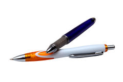 2 pens, isolated. Orange and dark blue pens, isolated Royalty Free Stock Photography