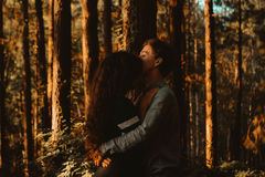 2 People Hugging Near Trees With Orange Sunlight Stock Photography