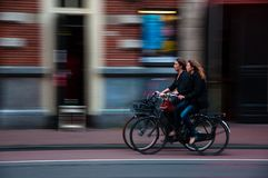 2 People Riding Bicycles on Sidewalk Stock Photos