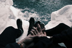 2 Person in Black Pants Sitting on Snowy Field Holding Hands Each Other during Daytime Royalty Free Stock Image