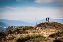 2 Person Hiking on Top of a Hill during Daytime Stock Images