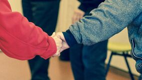 2 Persons Holding Their Hands Royalty Free Stock Images