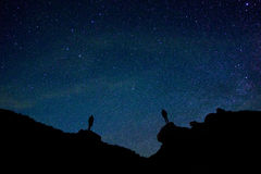 2 Persons Silhouette Under Starry Night Sky Royalty Free Stock Photo