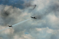 2 Planes with smoke ring. 2 military planes with smoke ring stock photography