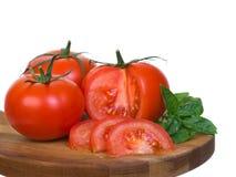 2 presentation vertikala skivade tomater Royaltyfria Foton