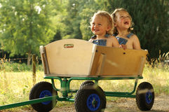 2 Pretty girls in a wagon Royalty Free Stock Photo