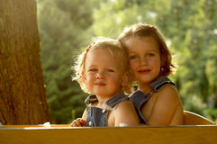 2 Pretty girls in a wagon Stock Photo