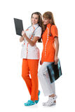 2 pretty nurse looking at the x-ray findings Stock Image
