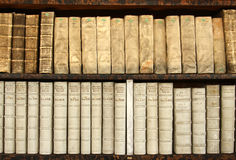 2 rows of bokks on a shelf. Many old books on a shelf Royalty Free Stock Images