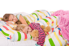 2 sleeping children. Two young children enjoying their colorful bed royalty free stock photography