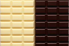 2 sorts of chocolate. White and dark brown chocolate in a row stock photo