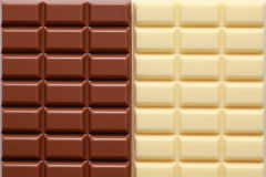 2 sorts of chocolate. Brown and white chocolate in a row royalty free stock image