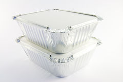 2 square foil catering trays. Two square foil catering trays on a white background Stock Photo
