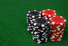 2 stacks of poker chips. On a green table Royalty Free Stock Photos
